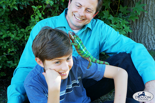 A dad, a boy, and his chameleon